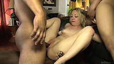 Her tight holes get drilled at the same time and the hot blonde sighs with pleasure