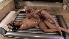 After a oily massage the Asian slutty babe gets ger shaved pussy boinked hard