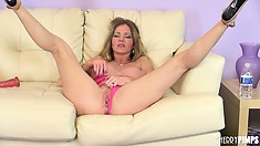 Busty brunette Amber Michaels plays with her big boobs and spreads