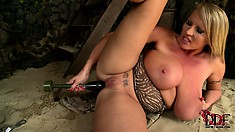 She licks her big nipples and inserts a huge black dildo in her ass and peach