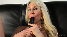Attractive lady Erica Lauren lies on the couch and satisfies her needs with a dildo