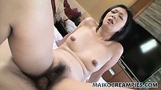 Sexy japanese babe gets her hairy snatch pounded down to the balls
