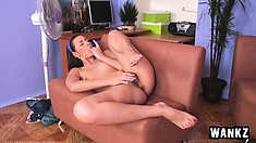 Christina lies on the couch and, spreading her sexy legs, fingers her twat to climax