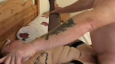 Short haired granny in black stockings gets fucked by a tattooed guy