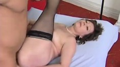 Insatiable mature woman in black stockings fucks a young stud's cock