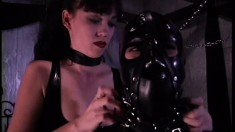 Latex fetish lady gets crammed into a box as part of her punishment