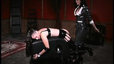 Leather fetishists Morgan Monroe and Kim Lee get their nipples clamped