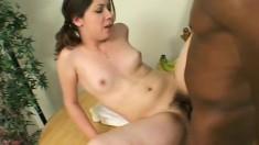 Petite brunette schoolgirl takes a huge black prick in her hairy peach