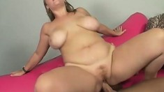 Busty blonde with an awesome ass and sexy legs rides a hard dick with intensity