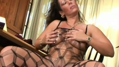 Slutty cougar with big tits Angelica caresses her body and delivers a great blowjob