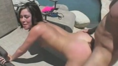 Sexy babe Ashley Blue has a stud deeply pounding her ass by the pool