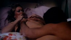 Charli lies on the bed and her man takes care of her sexual desires