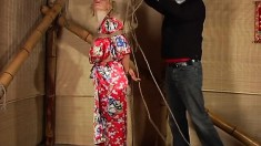 Busty blonde Taisia gets tied up in her robe and is suspended in air