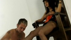 Dominatrix Victoria Sinn makes her slave grovel at her feet and punishes him