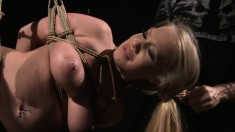 Tied up busty blonde babe is tortured and fucked like a sex slave