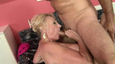 Stacked mature lady embarks on an intense adventure with a young man