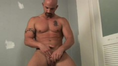 Muscled and hairless stud removes his jockstrap to diddle with his boner