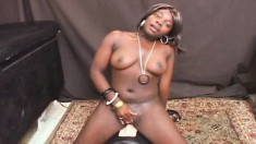 Big breasted ebony beauty Janice has an intense orgasm on the sybian