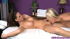 Sexy blonde and brunette hotties turn massage session into pussy licking