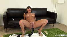 Ava Devine squats her oily ass on the big brutal dildo and rides it hard