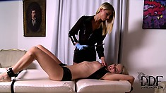 The slave is tied to the chair so she can accept her dom's fist