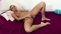 Pretty blonde bitch rubs her pussy lips and spreads her juicy ass