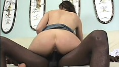 Gorgeous brunette invites a black stud to fill her needy holes with his massive rod