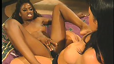Two magnificent lesbians enjoy an intense interracial lesbian experience on the bed