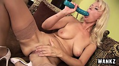 Mature blonde bitch tends to her cock-hungry twat with a big toy