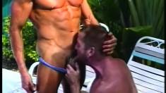 Muscular men Brett Hughes and Michael Vista share a moment of ass love
