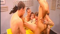 Five horny guys get together and experience an intense gay orgy