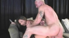 Stunning babe in fishnets gets fucked like a dirty whore by two dudes