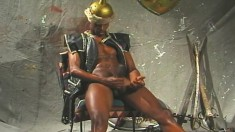 Dark skinned gladiator shows off his body and plays with his big stick