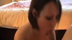 A busty house wife giving a blowjob till cumshot